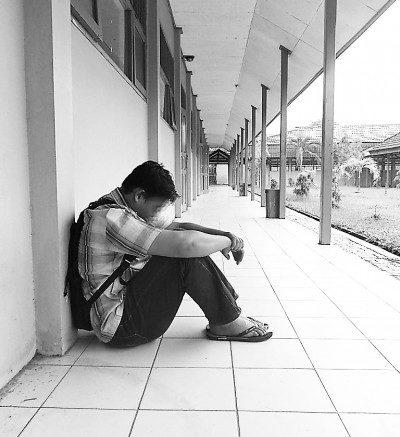 Illustrasjonsbilde trist gutt